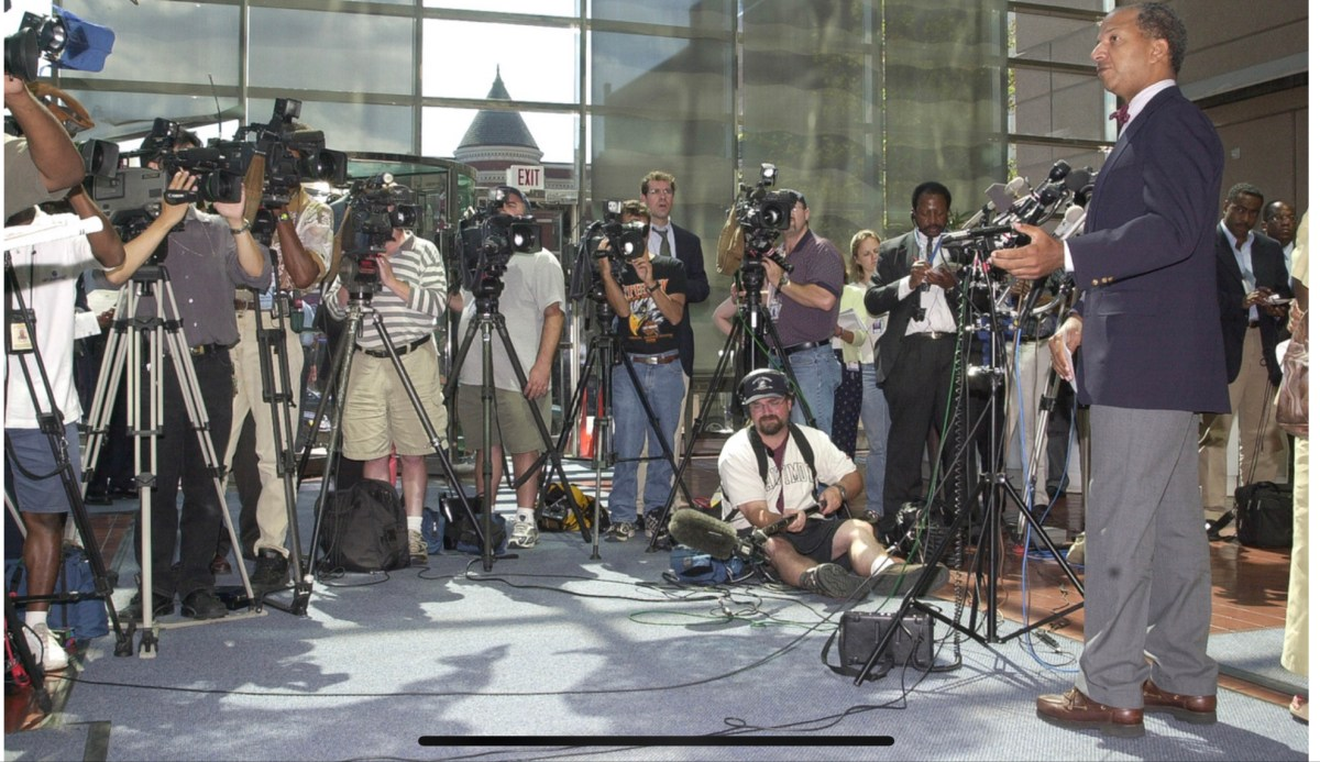 Reporters gather outside the Reeves Center in Washington D.C. as Mayor Anthony Williams speaks about the 9/11 attacks on Sept. 11, 2001.