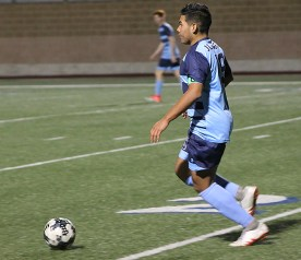 Senior Jaziel Martinez showcases his dribbling skills in open field. Photo by Mia Roth.