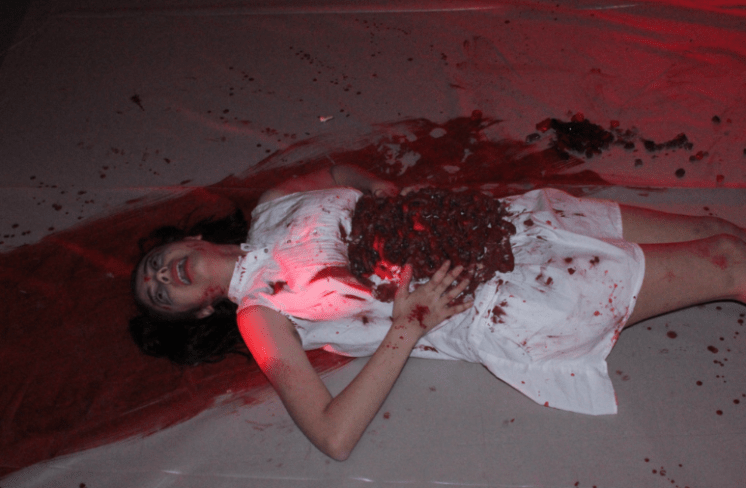 Sophomore Lauren Deleon, lays on the floor drenched in fake blood. photo by Victoria Boesen