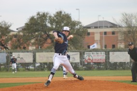 Senior Jason Palmer pitches the ball to the batter. Photo by Danielle Bellow.