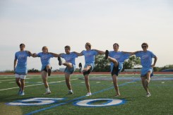 Junior boys attempt to do a kick line for half-time performance.