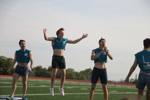 Senior boys get hyped up before half-time performance.