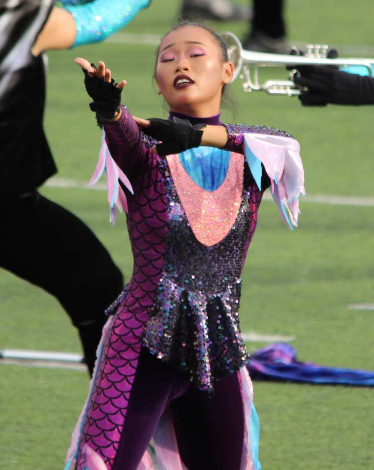 The colorguard are sirens for the performance. Photo by Adelin Blackmon.