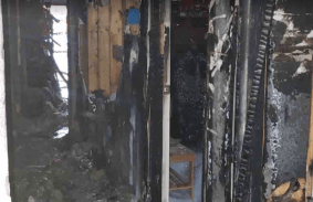 The fire spread throughout the house destroying most of the property, including this hallway.