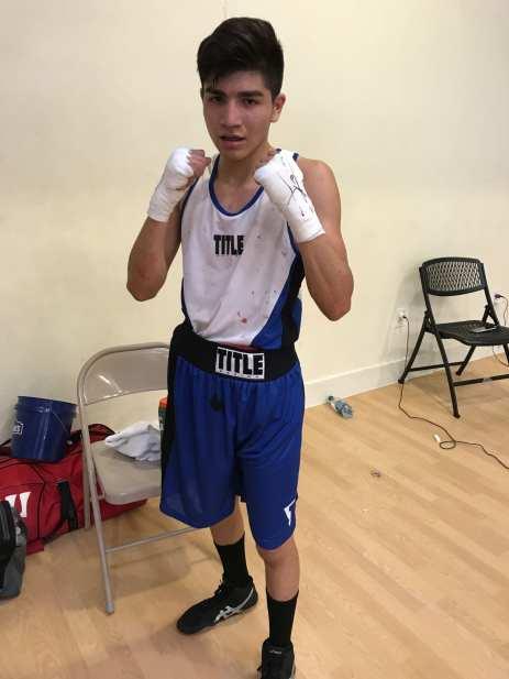 Senior Kevin Mendoza in hid boxing gear, preparing for a fight.