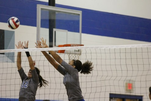 Junior Jade De La Rosa and senior BreAnn Ford paired up numerous times in the match resulting in several blocks. Photo by Jacob Dukes