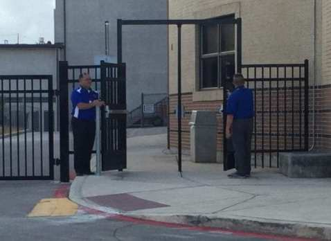 Mr. Martinez and Mr. Lewitt holding the gates open. Photo by Alexsis De La Garza.