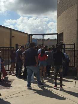 Students filing through the new gates after a fire drill. Photo by Alexsis De La Garza.