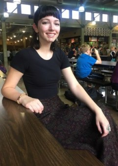 "Julia Dedick sits in the cafeteria before a long day of AP classes. ""I try to further your education as much as I can, but I think that experience is worth more in a monetary sense than schooling, especially in engineering. Although I'm into engineering, choir is my true passion and when I was accepted into chamber choir it was very rewarding to me. If I could follow my passion I would do something in singing, but engineering is definitely where the money is and is more realistic for me,"" Dedick said. PHOTO BY B.MELENDEZ"