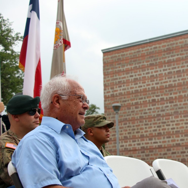 The audience of the currently enlisted and citizens listen to Col. Ricardo Morales's speech.