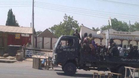 Boko Haram making a quick run to distribute anti-voting flyers in Gombe town last week