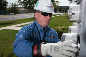 A CPS Energy employee relaces a customer's analog meter with a smart meter.