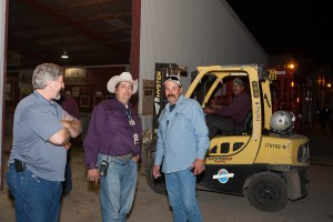 Edwin Martin, center, a production supervisor at CPS Energy, oversees more than 1,200 volunteers each year at the Stock Show & Rodeo.