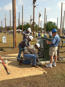 """CPS Energy journeyman team tackles the """"URD elbow change-out"""" in Kissimmee last month."""
