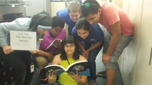 Internships aren't all work: Fritzi Davis, center, works with her team during a scavenger hunt.