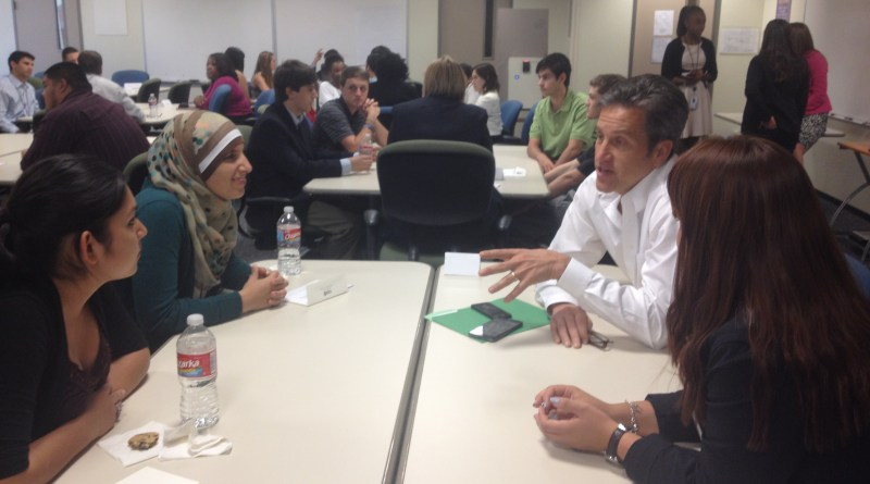 (Image) Executive VP Cris Eugster, right, talks to interns about what it takes to run CPS Energy