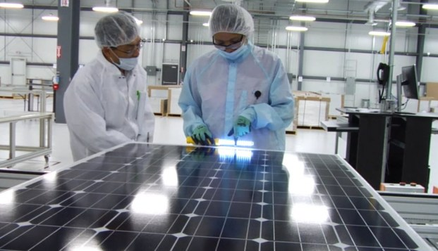 Mission Solar employees inspect each solar module at the manufacturing facility at Brooks City Base.