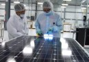 (Image) Mission Solar employees inspect each solar module at the manufacturing facility at Brooks City Base.
