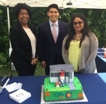 Interim CEO & President Paula Gold-Williams, District 4 Councilman Rey Saldana help Crystal Granato celebrate her home being the 15,000th to be weatherized.