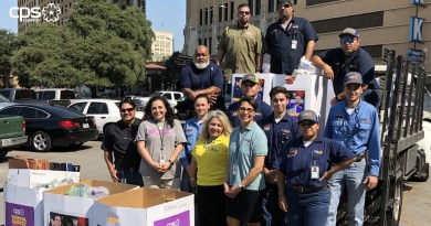 Team members, interns Stuff the Bus with two tons of school supplies