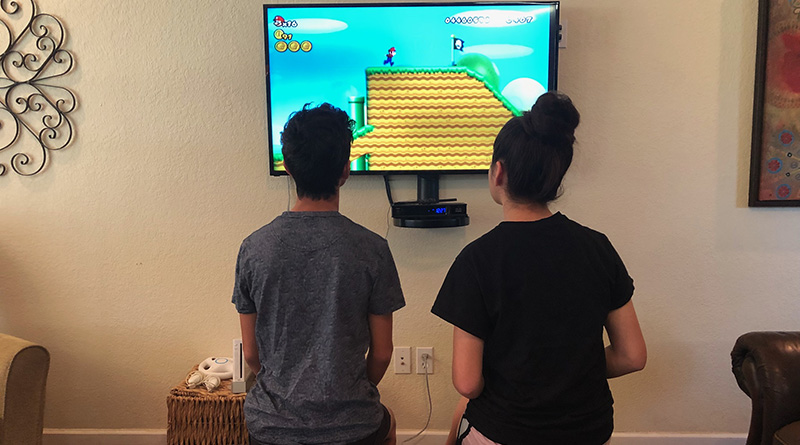 Two kids playing video games at home