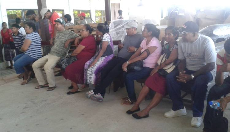 Persons waiting to receive vaccine