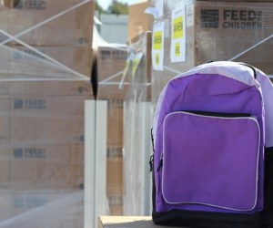 An image of a backpack in front of boxes