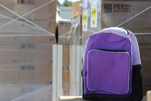 backpack in front of boxes