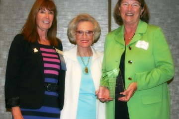 Susan Henry, president of the Huntington Beach Union High School District's Board of Trustees, with an award