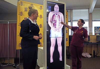 Students demonstrate the Anatomage Table