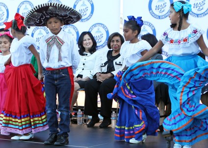 student performers dance on a stage