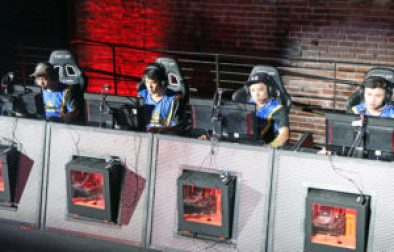 students sit in front of monitors competing in online gaming