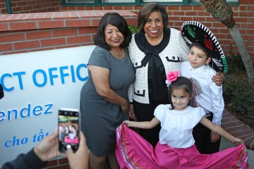 silvia mendez poses for photo with children and relatives