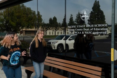Students in front of Pacific Coast High School