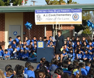 The principal of Cook Elementary School leads an outdoor assembly