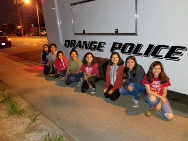 FNL students in front of an Orange Police vehicle