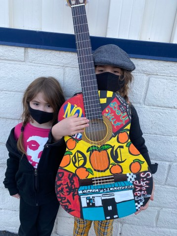 Children with painted guitar