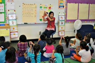 Teacher Van Anh Vu with students in the classroom