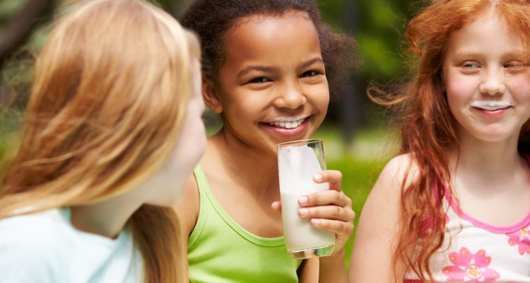 An image of smiling girls drinking milk