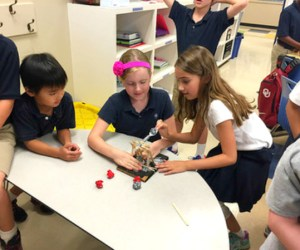 STEM students with launch machine