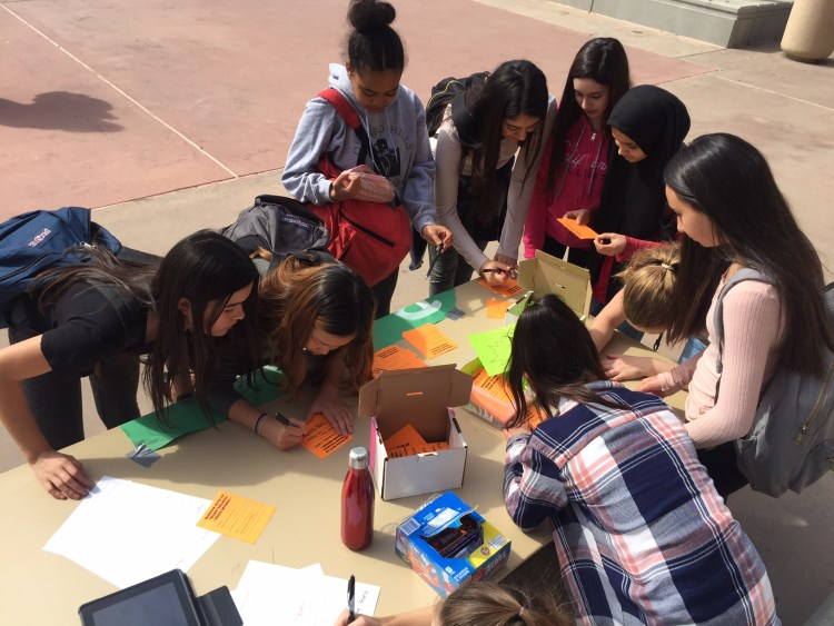 Students participating in kindness activities outside