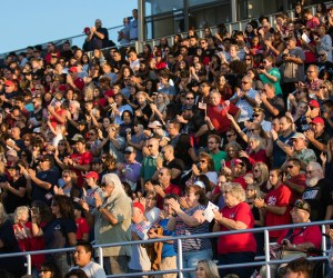 Community members cheer during the dedication ceremony for the Michael A. Monsoor Memorial Stadium