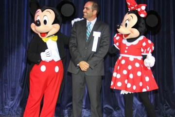 Vincent Saporito stands with Mickey and Minnie Mouse
