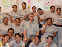 Allen Witten, teacher at Sunburst Academy, surrounded by students