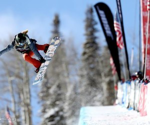 snowboarder Chloe kim performs a jump on the half pipe