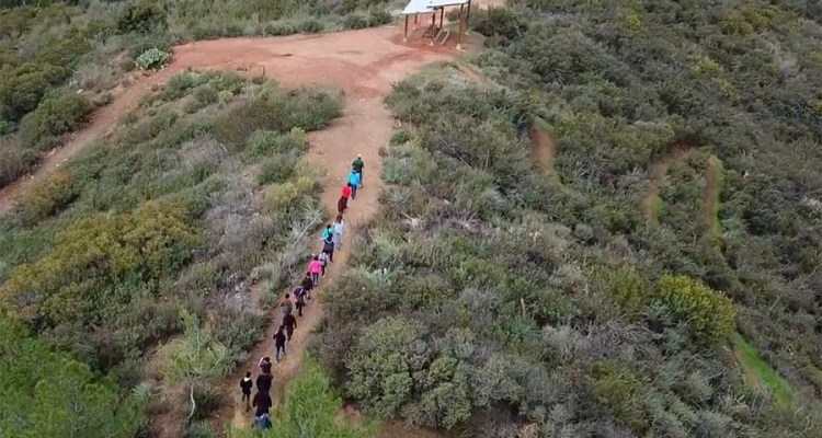 Students hike up a hill