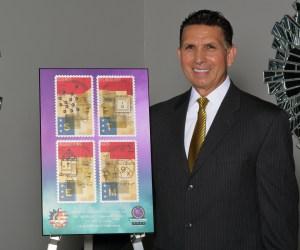 Dr. Al Mijares next to an award