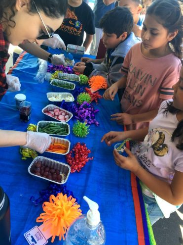 Walnut Elementary students line up for servings of fruit and vegetables