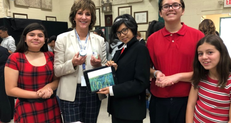 students pose with superintendent Joanne culverhouse