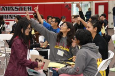 students give thumbs up